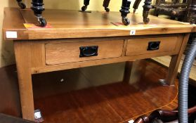 BESPOKE OAK TYPE COFFEE TABLE FITTED WITH TWO SHALLOW FRIEZE DRAWERS EACH SIDE (110CM X 60CM X 45CM