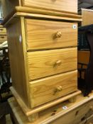 PAIR OF PINE THREE DRAWER BEDSIDE CHESTS AND AN OVAL MAGAZINE TABLE