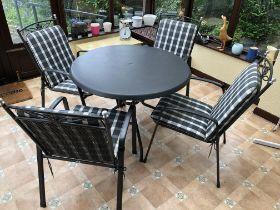 CIRCULAR PATIO TABLE AND FOUR CHAIRS WITH PADDED CUSHIONS