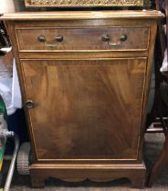 MAHOGANY CROSSBANDED CUPBOARD FITTED WITH A SINGLE DRAWER
