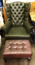 BOTTLE GREEN BUTTON BACKED FAUX LEATHER WING ARMCHAIR ON CABRIOLE LEGS AND BROWN LEATHERETTE FOOT