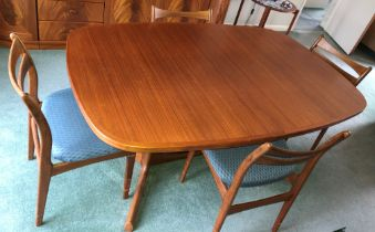 TEAK CROSS BANDED OVAL DINING TABLE AND SIX TEAK LADDER BACK CHAIRS
