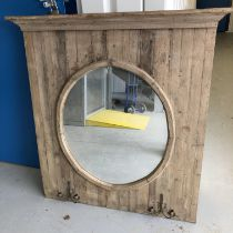 SLATTED CIRCULAR MIRRORED WALL PANEL WITH WROUGHT IRON TWIN CANDLE HOLDERS