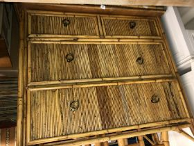REEDED BAMBOO FRONTED CHEST OF TWO OVER TWO DRAWERS