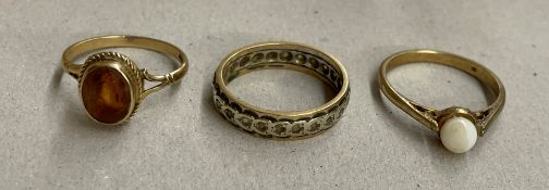 9CT GOLD AND CITRINE DRESS RING, UNMARKED ETERNITY BAND, AND 9CT GOLD SOLITAIRE RING, SIZES K/L 6.