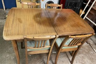MAHOGANY EXTENDING DINING TABLE AND FOUR VERTICAL SLAT BACK DINING CHAIRS
