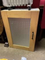 GLAZED CABINET AND A HEATER