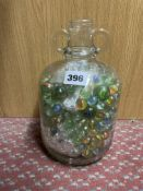 SMALL FLAGON OF GLASS MARBLES