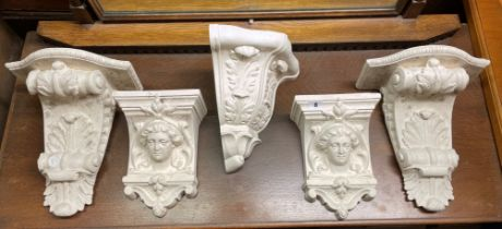 PAIR OF ACANTHUS SCROLL CORBELS, PAIR OF FACE MASK CORBELS,