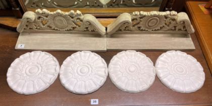 FOUR PETAL ROSETTES AND PAIR OF LIME WOOD EFFECT CARVED WALL SHELVES