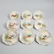 Nine Limoges Game Plates, early 20th century, diameter 9.4 in — 24 cm (9 Pieces)