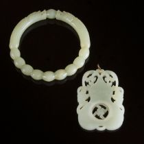 A White Jade Pendant, Together With a Pale Celadon Jade 'Dragon' Bangle, Late Qing Dynasty, 19th/20t