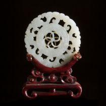 A White Jade Reticulated Circular Plaque, Qing Dynasty, 清 白玉透雕转心佩, diameter 2.3 in — 5.8 cm