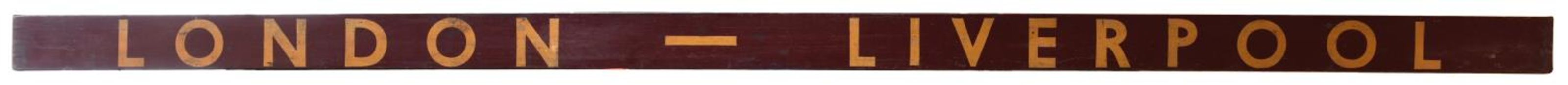 An LMS carriage board for the Manxman train. Wooden board with painted maroon background and