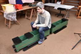 A 5 inch gauge articulated railway carriage for ground level running. Well constructed wooden bodies