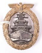 A Third Reich High Seas Fleet badge, with gilt washed wreath and silver/grey centre, the unmarked