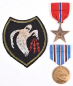 """USA WWII bronze star and African campaign medals, EF and NVF; and an embroidered patch of the """"Ghost"""