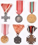6 WWI Austrian and other war medals: Austrian Iron Cross of Merit without crown, post 1917 Medal for