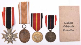 Third Reich medals: War Merit Cross 2nd Class with swords, War Merit Medal, West Wall Medal with