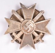 A Third Reich War Merit Cross 1st class with swords, with rare screw back fitting. Near VGC £50-80