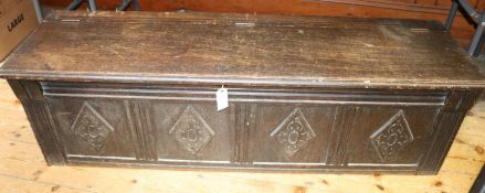 An 19th Century oak coffer chest (in an earlier 18th Century style). Well made and of narrow