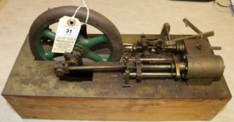 A live steam stationary engine. A scratch built single cylinder engine of some age. Generally well