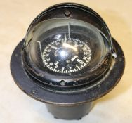 A Sestral Marine compass. Self leveling compass encased within a stand with sectional lid. Henry