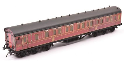 An O gauge 12-wheel Brake First compartment coach by Stedman. Litho printed paper sides in lined