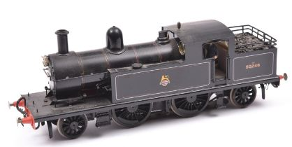 A finescale O gauge kitbuilt brass model of a BR 2-4-2T locomotive, 50746, in lined black livery.