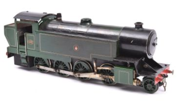 A live steam coarse scale O gauge locomotive. Spirit fired 2 cylinder tinplate model of a Great