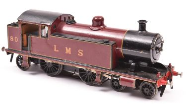 A coarse scale O gauge tinplate model of an LMS 4-4-2T locomotive, 80, in lined maroon livery.