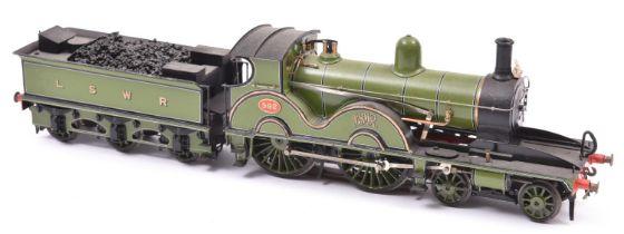 A finescale O gauge kitbuilt model of an LSWR Class X2 4-4-0 Adams tender locomotive, 592, in