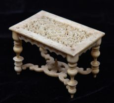 A very finely worked mid 19th Century oriental ivory doll's house model table with 17th Century