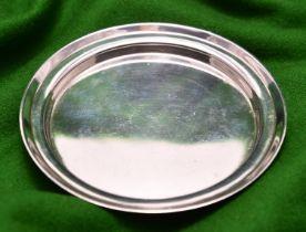 A small silver coaster/tray raised on 3 flattened ball feet. Hallmarked London 1883, 'FH'. 112g.