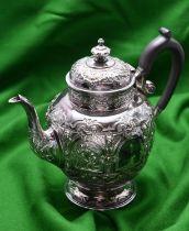 A highly decorative silver coffee pot by Edward & Sons, Glasgow. Hallmarked Glasgow 1894. With