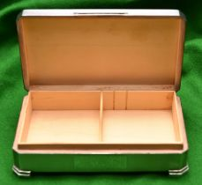 A silver cigarette box with engine turned decoration to lid and sides, cedar lined interior and