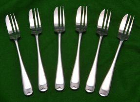 A set of six silver cake forks of plain design. Hallmarked Sheffield 1937, 'EV'. VGC. £20-40
