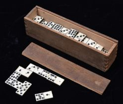 A 19th Century Domino set. 49x playing pieces of bone and ebony (or ebonised wood) construction,