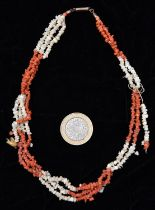 A mid-Victorian red and white 3-strand coral necklace made up of small pieces. GC, requires