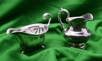 A Russian silver cream jug. Hallmarked for St. Petersburg 84, 1853 and unknown Cyrillic maker's