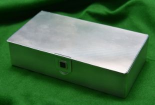 A silver cigarette box with onyx inlay latch and gilt wash interior. Hallmarked London 1936, 'C&