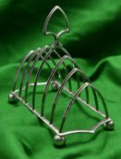 A 7-bar silver toast rack with simple gothic arches. Hallmarked Sheffield, 'J.H.P'. VGC. 207g. £50-