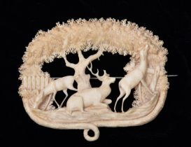 A very finely worked 19th Century Victorian ivory brooch depicting a very detailed scene with