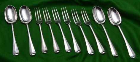 A matching collection of 6x silver forks and 4x silver dessert spoons all with matching crest on