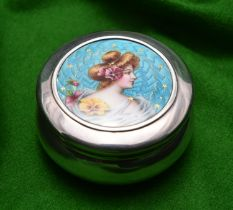 A silver round pot with removable lid and gilt washed interior. Engine turned enamel lid with a