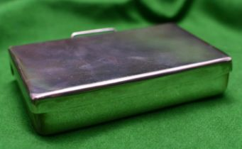 A silver sandwich box of plain design. Double hinged box with carrying handle. Hallmarked