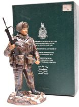 An Ashmor hand painted Fine Bone China figure representing a Falklands War soldier of the 1st Bn 7th