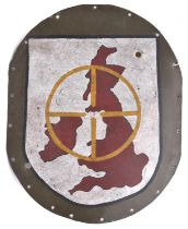 An oval aluminium panel, with border of rivet holes, and with painted shield depicting the British