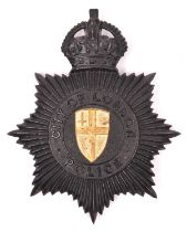 """A rare City of London Police 1934 """"Home Office"""" pattern helmet plate, black with gold City of London"""