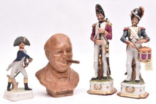 A pair of glazed porcelain figures of Napoleonic French soldiers, comprising a drummer and an